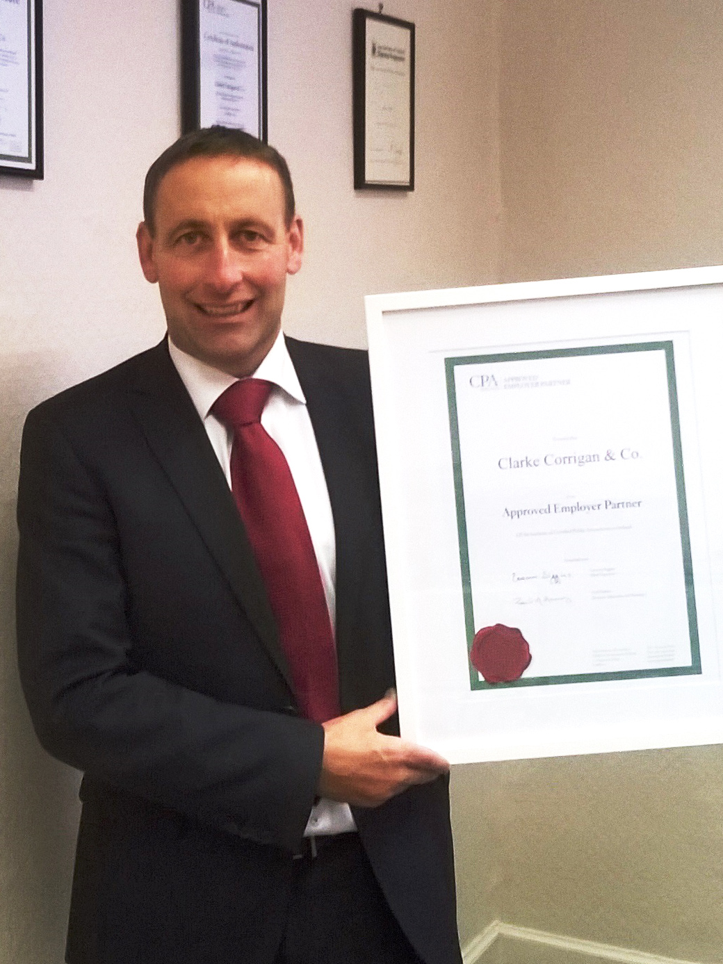 Barry Clark Clarke Corrigan receiving CPA Approved Employer Certificate